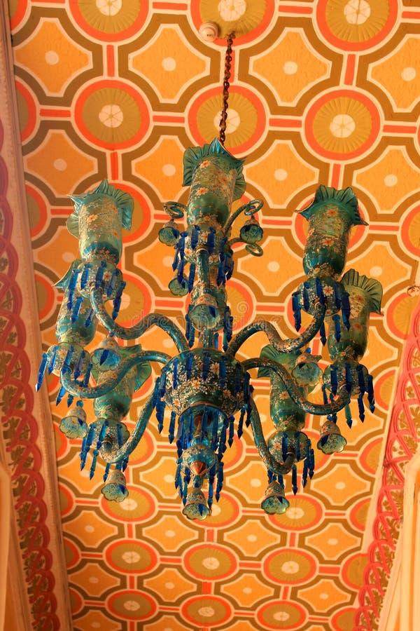 Old antique ornamental blue lamp set in the palace of bangalore. Bangalore Palace, a palace located in Bangalore, Karnataka, India. Construction of a palace royalty free stock photo