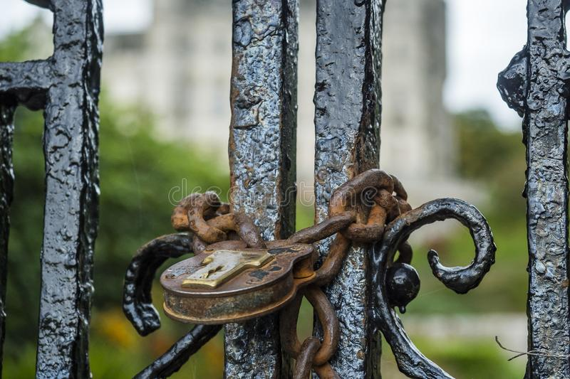 Old antique padlock. In front of an iron gate in the Scottish Highlands royalty free stock photography