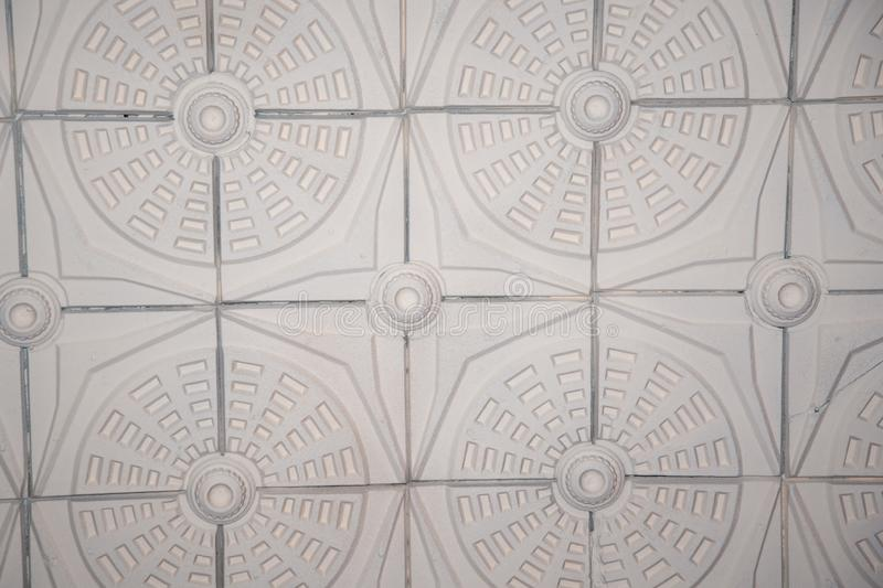 Old antique plaster ceiling with floral elements stock photos