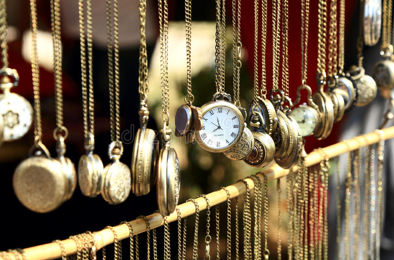 Old antique pocket watch on the market. Old antique pocket watch exposed for sale on the market, selective focus royalty free stock photo