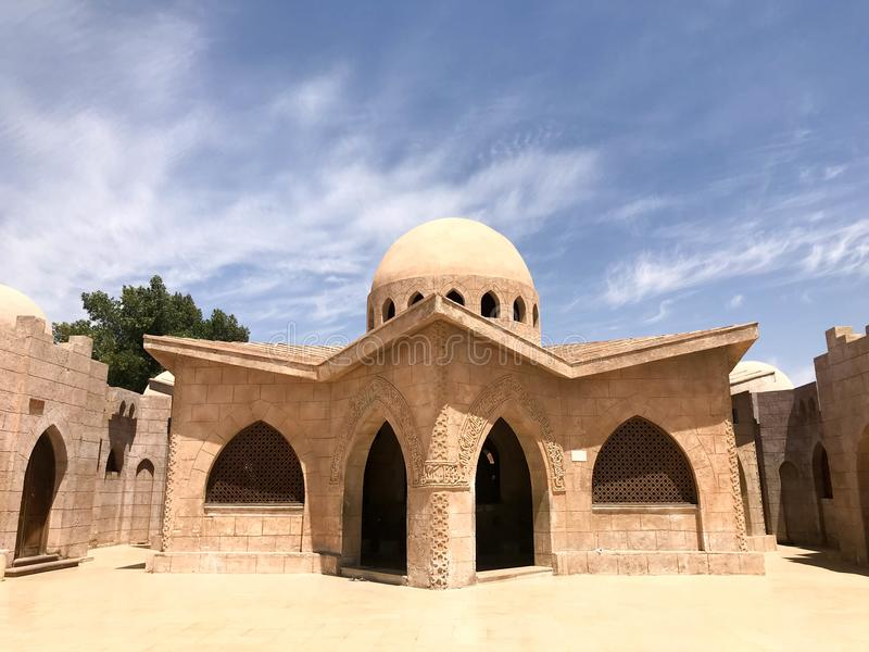 An old antique sturdy small stone beige building with a round roof in an Arab Muslim Islamic warm tropical country in the desert stock photos
