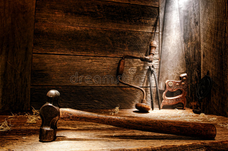 Old Antique Tools in Vintage Carpentry Workshop royalty free stock images