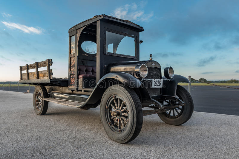 Old Antique Truck with Wood Bed. Old 1926 Pickup truck with a wood bed shoot at sunrise near and airport stock photo