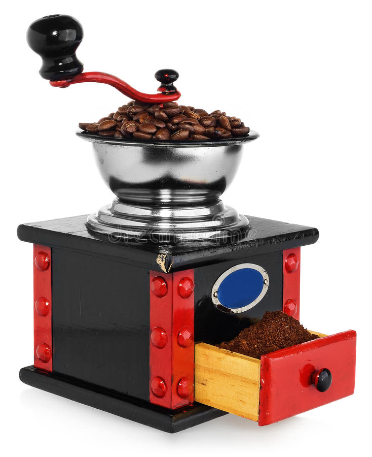 Old antique wooden black and red coffee grinder, coffee beans an stock photo