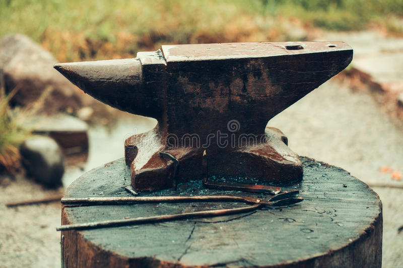 Old anvil and tongs stock photos