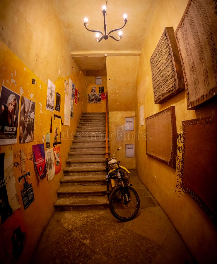 Old apartment hallway stairs going up stock photos