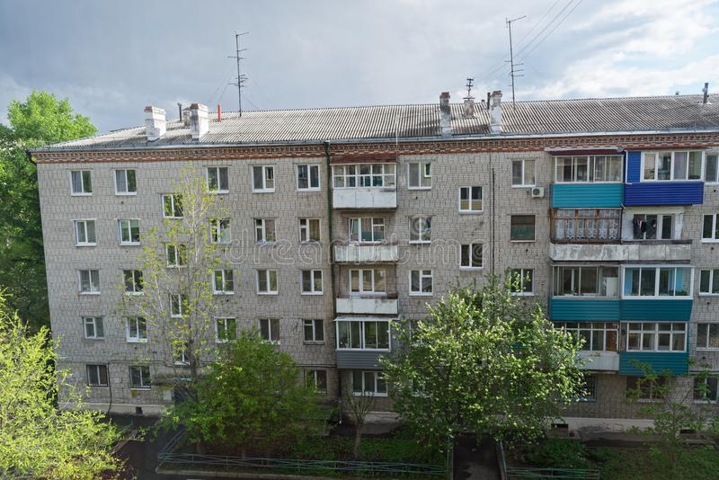 Old apartment house against cloudy sky. Komsomolsk-on-Amure, Russia. Old apartment house against cloudy sky. This house is located in Komsomolsk-on-Amure, Russia royalty free stock photography