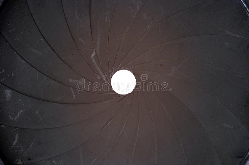 Old aperture. Technical detail of the old aperture - light curtain - exposure diaphragm stock photo