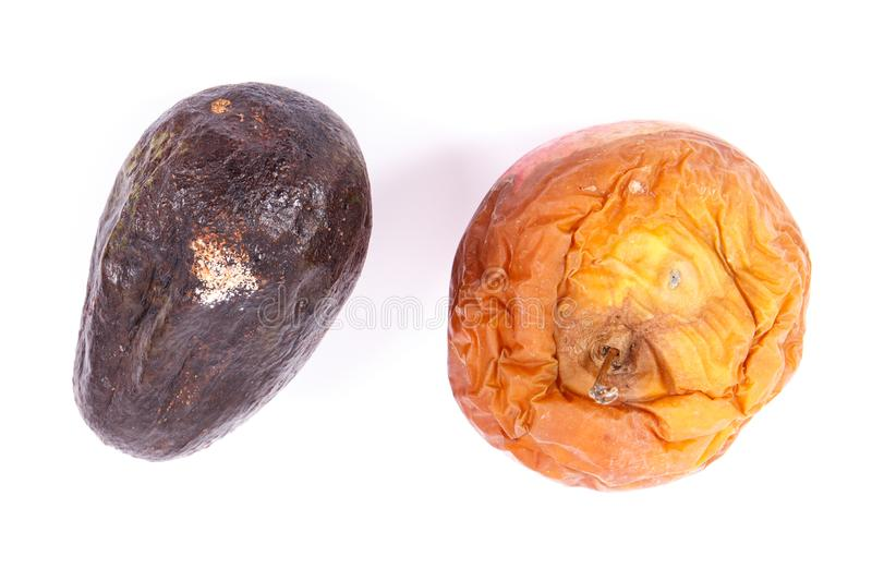 Old apple and avocado with mold on white background, unhealthy and disgusting food. Old wrinkled apple and avocado with mold on white background, unhealthy and stock photo