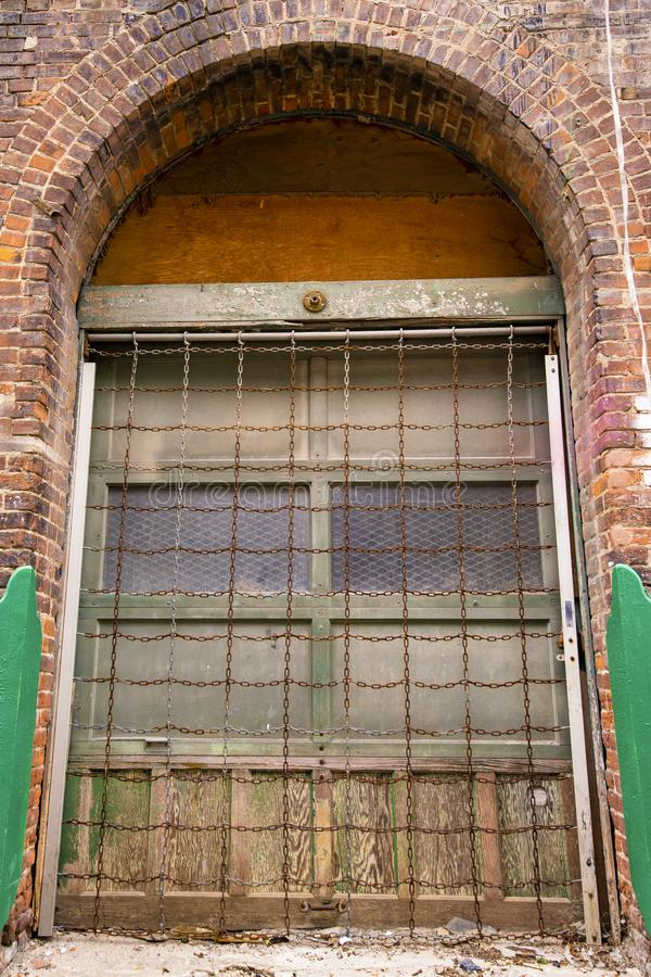 An old arched door on a brick building stock photo