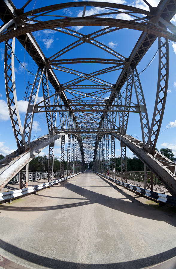 Old arched metal bridge. In Novgorod region, Russia. View from inside stock images