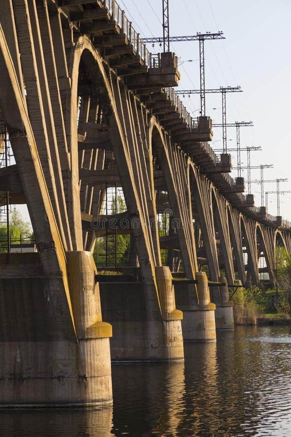 Old  arched monolithic concret railway bridge close-up. Old arch bridge, monolithic reinforced concrete railway, the Merefa-Kherson bridge across the river stock photo