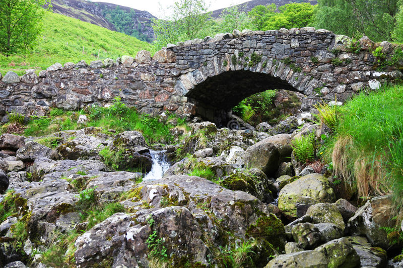 Old arched stone bridge. In Lake District National Park, Cumbria, England stock photo