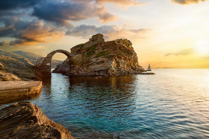 The old arched stone bridge leading to the ancient Castle of Andros island, Greece royalty free stock image