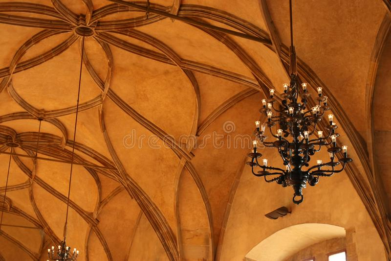 Old Architectural Details over antique ceiling with vintage chandelier stock photo