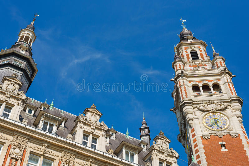 Old architecture in Lille. Chamber of commerce in Lille in a summer day under the blue sky stock photo