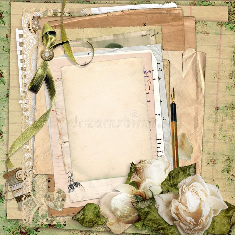 Old archive with letters and envelopes with a card for text or photo, with dried roses, ribbon and lace royalty free stock photo