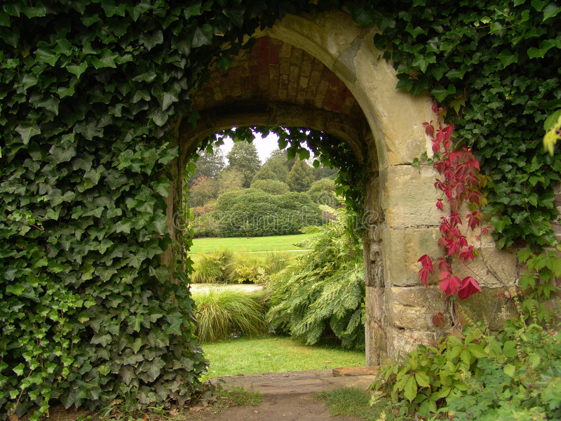 Old archway in garden stock image