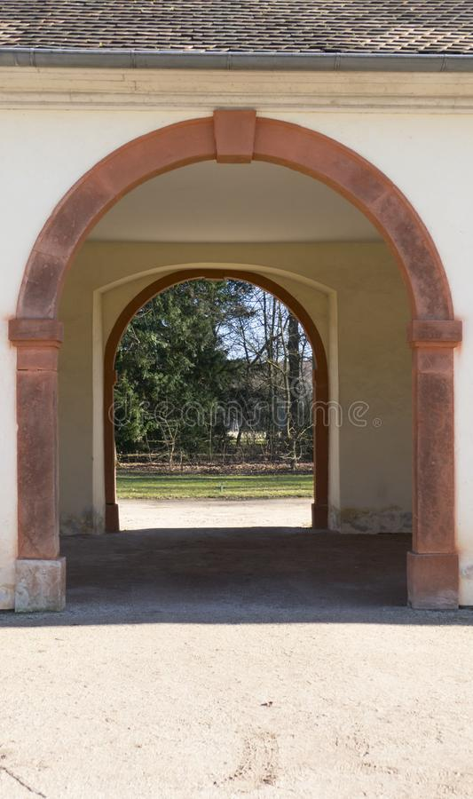 Old archway, passageway in a public outbuilding, with castle Favorite stock photo