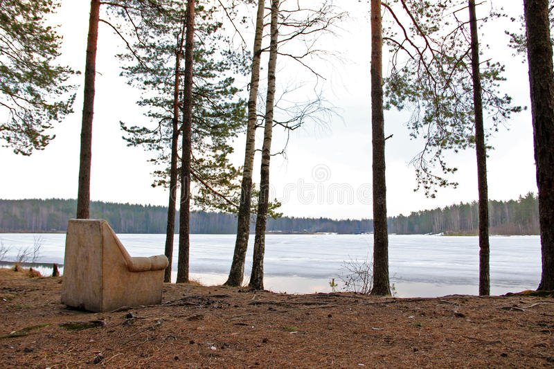 The old armchair in the forest on the Lake Shore royalty free stock photo