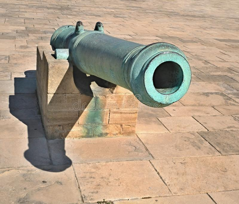 Old artillery gun. The gun for the cores, covered with patina stock photos