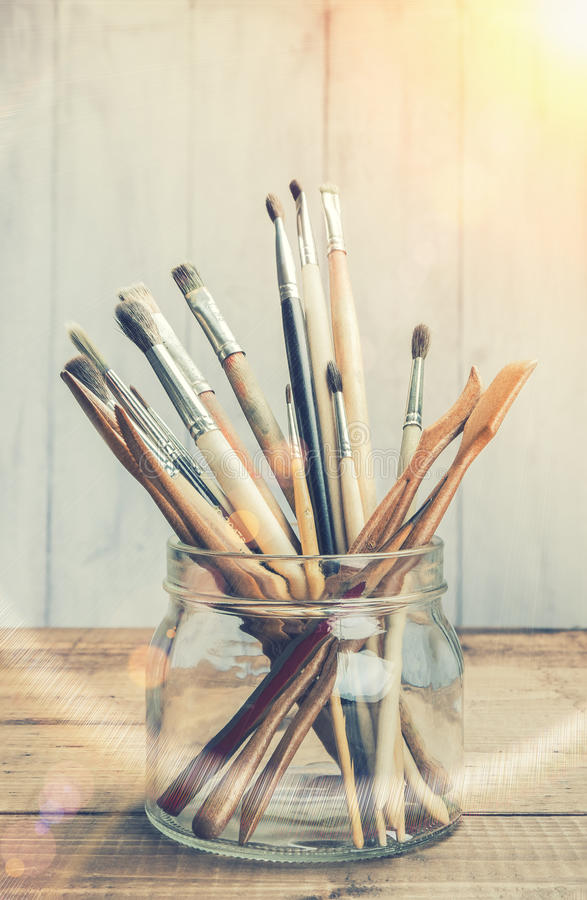 Old artist's brushes in sunlight royalty free stock image