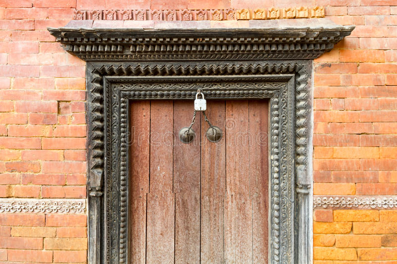 Old Artistic Wooden Door. Old and artistic wooden door of Nepal with the unique vintage look royalty free stock images