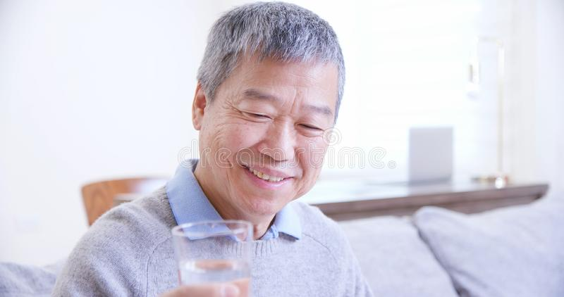 Old asian man drink water royalty free stock images