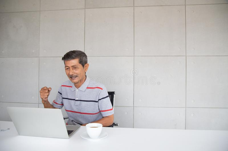 Old Asian man happy and smile with his success royalty free stock photo