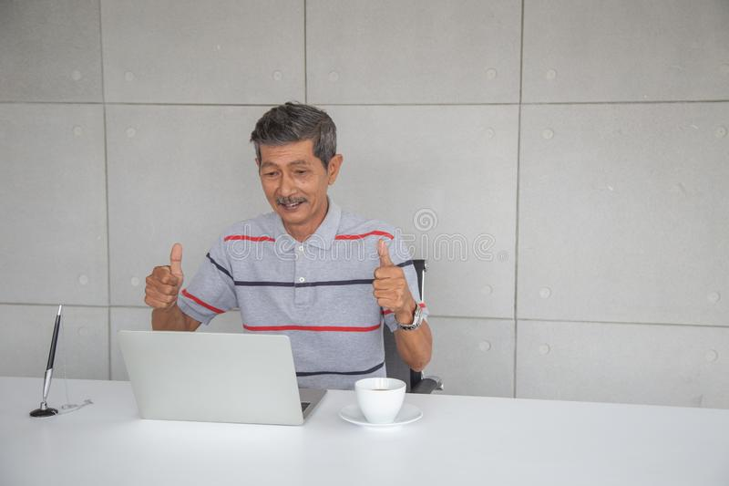 Old Asian man happy and smile with his success royalty free stock photography