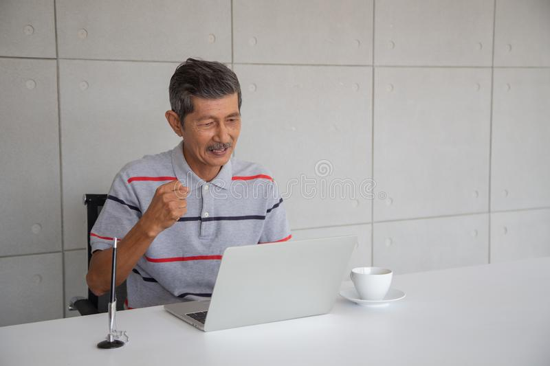 Old Asian man happy and smile with his success royalty free stock photos