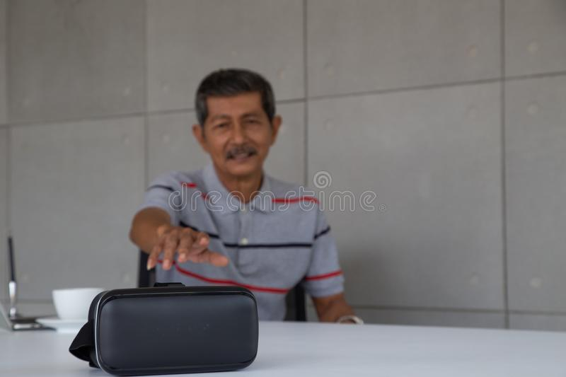 Old Asian man interest new technology VR stock photography