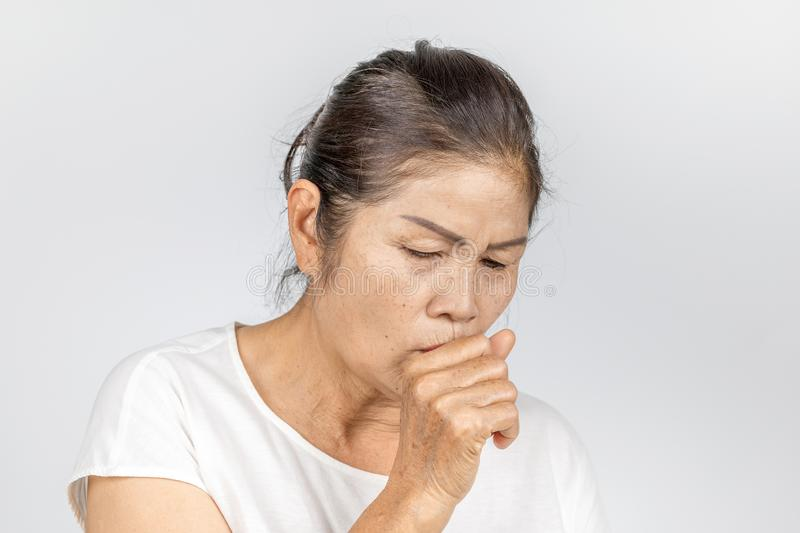 Old asian woman coughing bronchitis or asthma royalty free stock photos