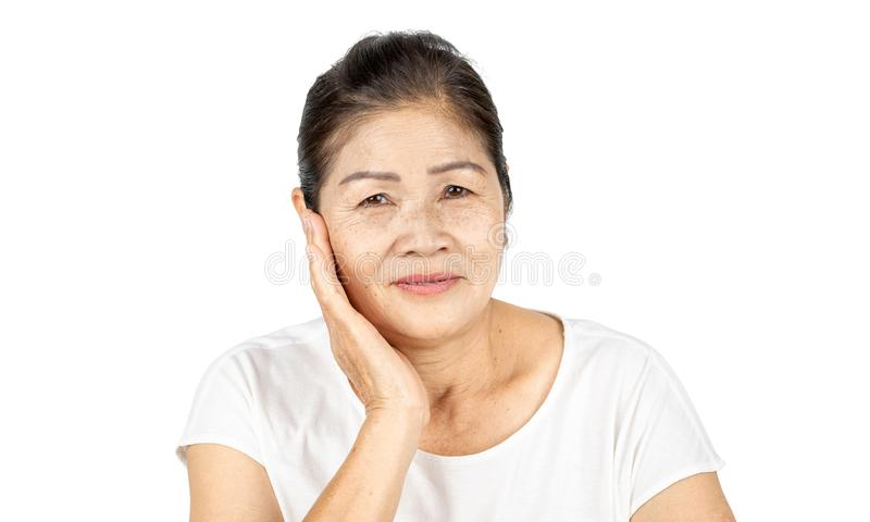 Old asian woman in isolated studio head shot with beauty concept stock photo