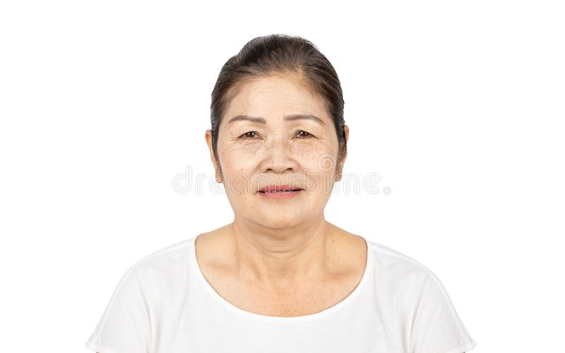 Old asian woman in isolated studio head shot with beauty concept stock photography