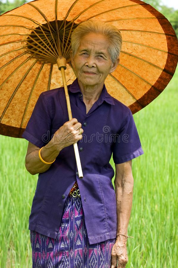Old Asian woman with parasol royalty free stock images
