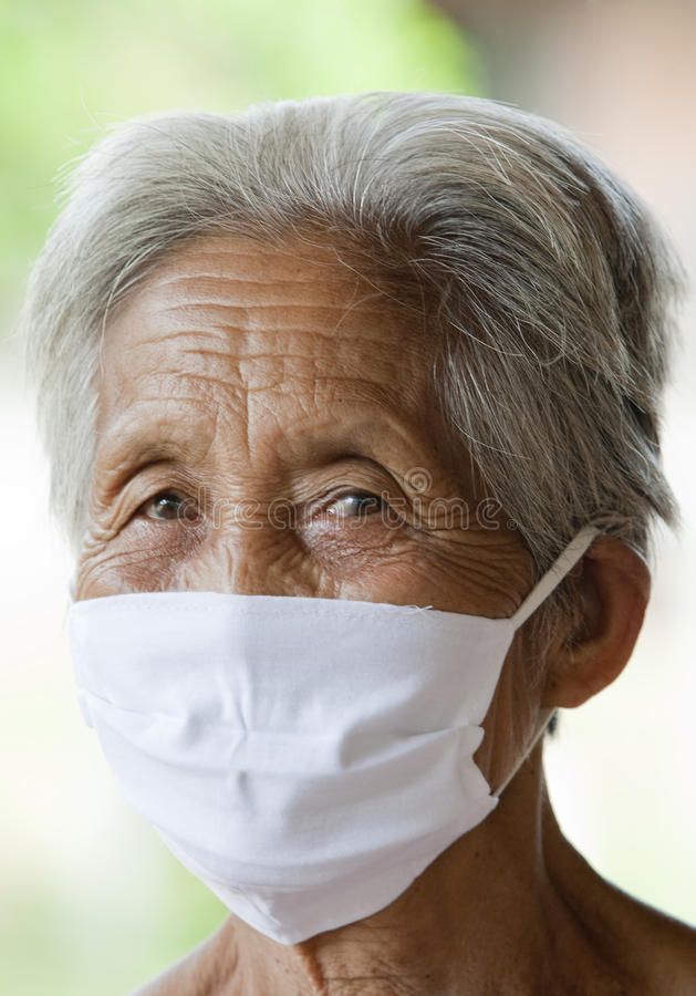 Old Asian woman with protective mask royalty free stock photos