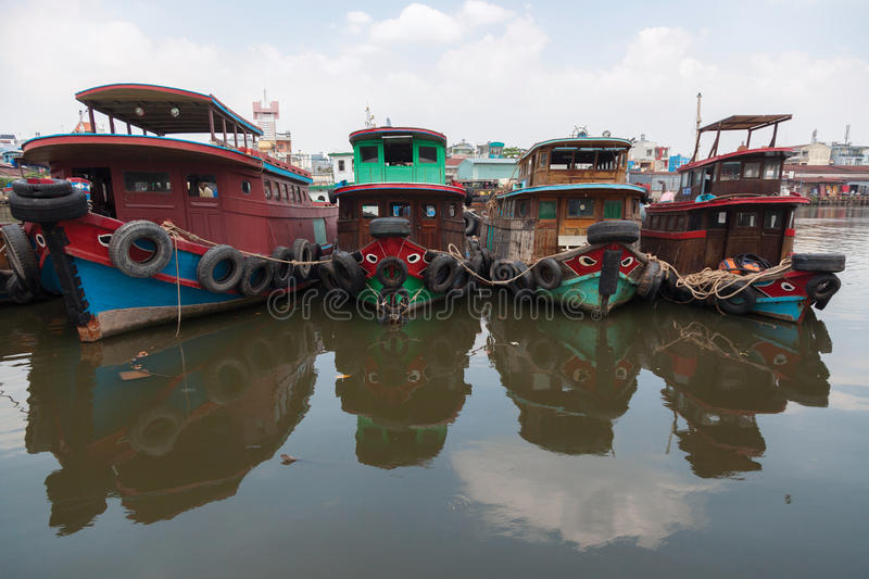 Old Asian wooden boats. Old wooden boats at Saigon river in Vietnam royalty free stock images