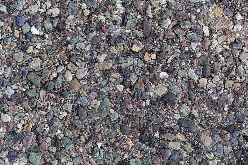 Old asphalt street pavement. With different colored stones as additive royalty free stock images