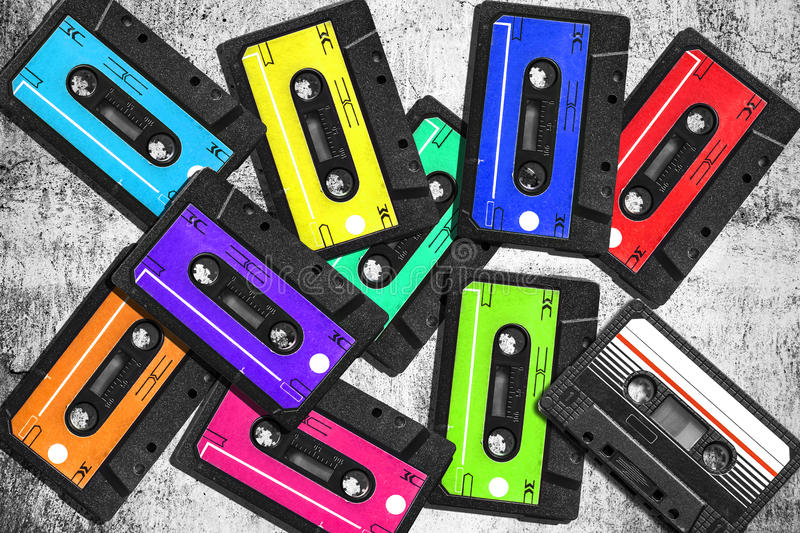 Old audio cassette. Multicolored audio tapes. Close-up view. The concept of old music. large collection of retro cassette tapes. stock photography