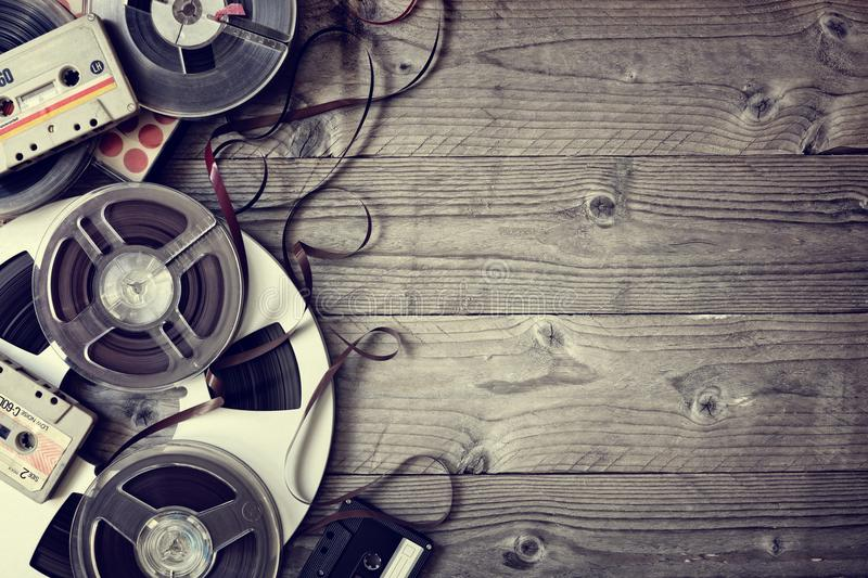 Old audio reels and cassette tape background royalty free stock image