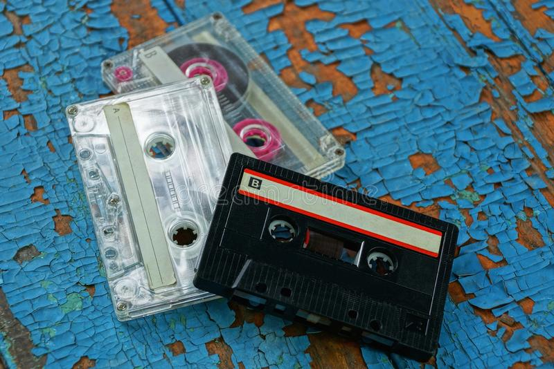 Old audio tapes are on the blue board royalty free stock image