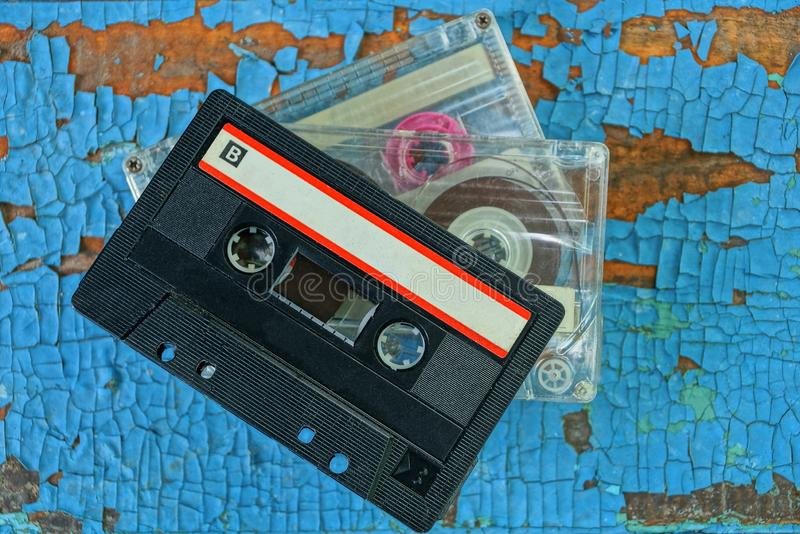 Old audio tapes are on the blue board stock image