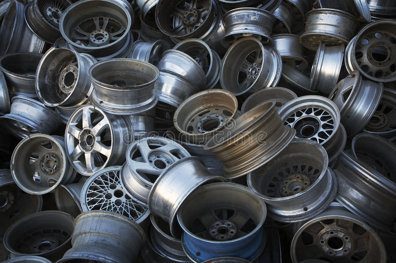 Old Automobile & Truck Wheels. Old truck and car wheels are piled high, ready for recycling royalty free stock image
