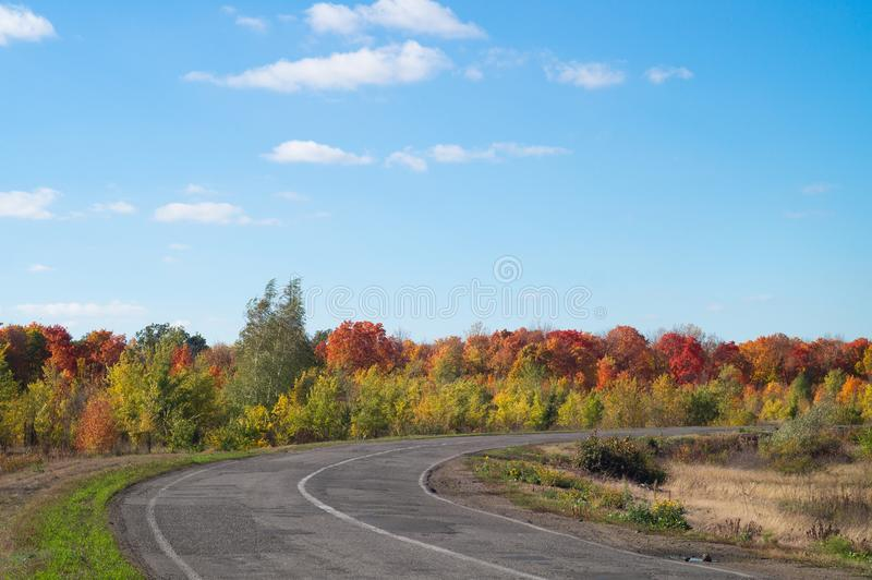 Old autumn road. Fall landscape under a clear blue sky stock photography