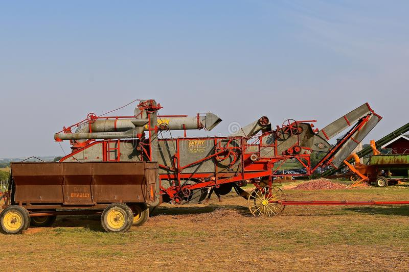 Old Avery threshing machine. ROLLAG, MINNESOTA, Sept 1, 2017: An old Avery threshing machine and David Bradley wagon box is displayed at the annual WCSTR farm royalty free stock image