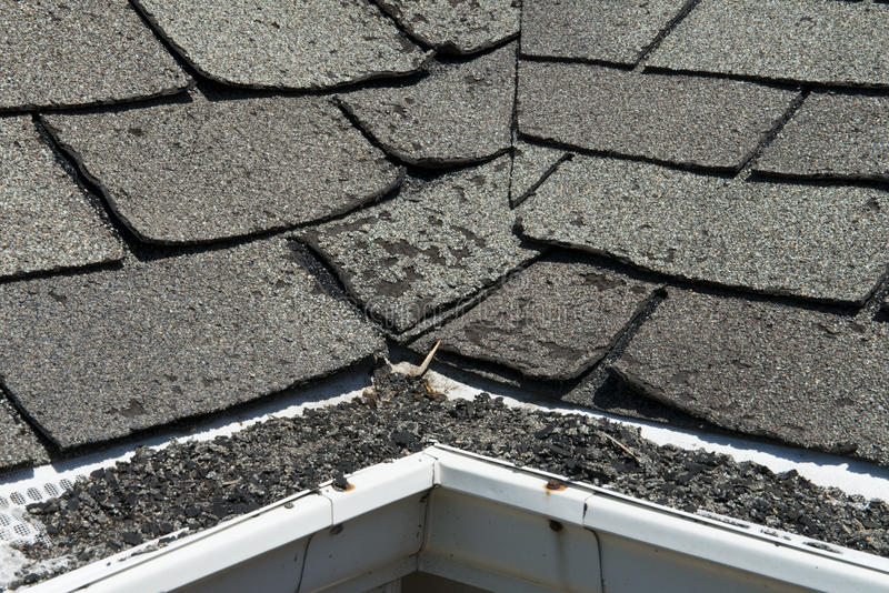 Old Bad and Curling Roof Shingles on a House or Home. Here comes another expensive home improvement project! The contractor is going to love you! Here you can royalty free stock image
