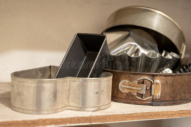 Old baking molds on an old kitchen table. Baking accessories in. The kitchen. wooden table royalty free stock photo