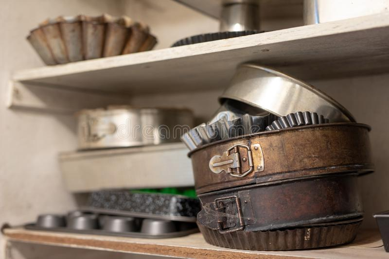 Old baking molds on an old kitchen table. Baking accessories in. The kitchen. wooden table stock images