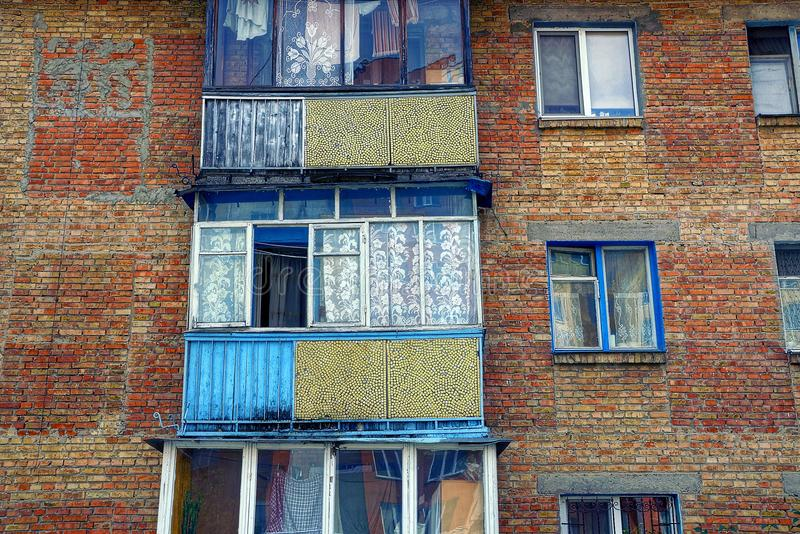 Old balconies with windows on the brick wall of the house royalty free stock photo